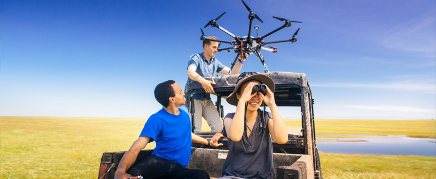 UC Merced Extension - Students preparing to launch drone in the pastures behind UC Merced.